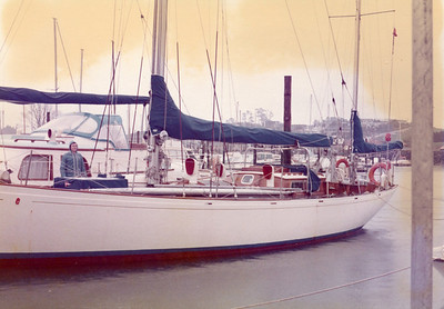"""Me, between """"Kochab II"""", the Alan Buchanan design, which Dad regarded as an ideal ocean cruising yacht; and behind the Rhodes design, """"Val Kay"""" a steel motorsailer, about 53 ft., both. Already showing rusting fastenings, a terminal disease for a magnificent yacht."""