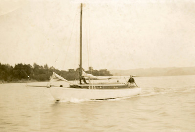 """I think this is the """"Haerere"""" with Dad at the helm, probably early 1950s. The boom length suggests she is gaff rigged, and note running back stays. Rigged as a cutter."""