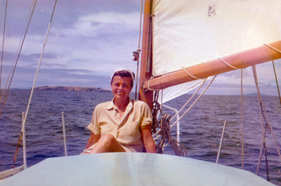 An earlier, lovely photo of Mum, the time we hired a 22 ft. Townsend design, chine in plywood, and sailed out to the Great Barrier Island. Here with Rangitoto to starboard and probably Tiri Tiri Matagi or Rakino to port, most likely we are sailing back from a stopover at Kawau Island.