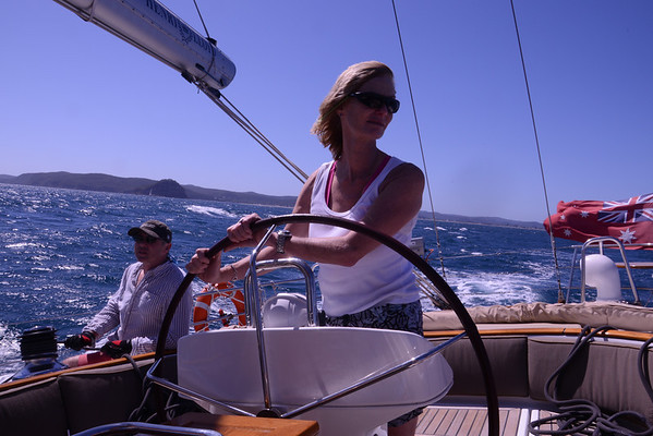 Our guest at the helm, coastal sailing in a fair breeze.