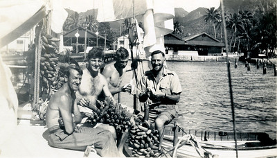 Bananas galore! The thin crew with Dad on right. Sheets substantial, probably of hemp, none of today's multistrand flexible nylon. Clinker planked timber dinghy. At Rarotonga.